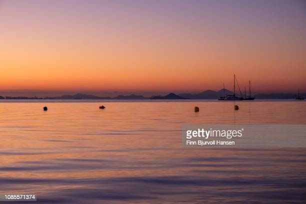 cityscape of la manga from mar menor spain - sunrise after the longest night in history - finn bjurvoll stock photos and pictures