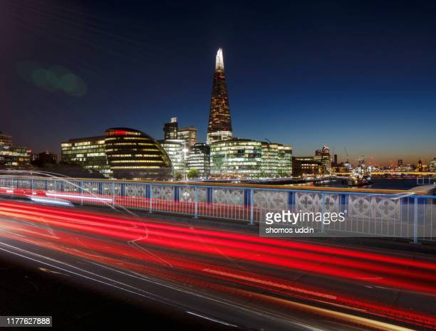 cityscape of london illuminated at twilight with light trail - southwark stock pictures, royalty-free photos & images