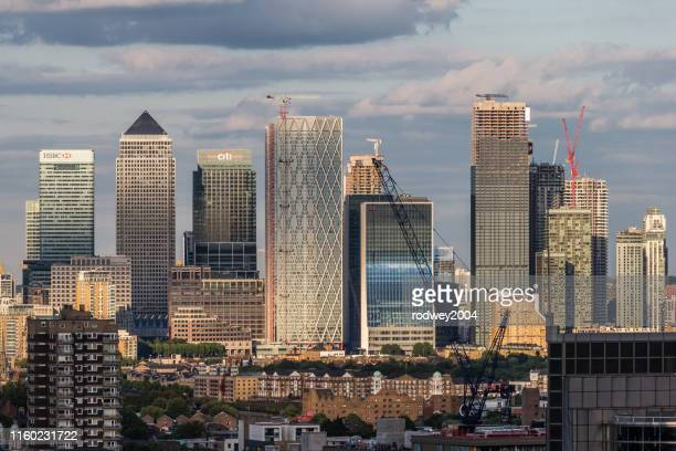 a cityscape of london with a view of canary wharf. - canary wharf stock pictures, royalty-free photos & images