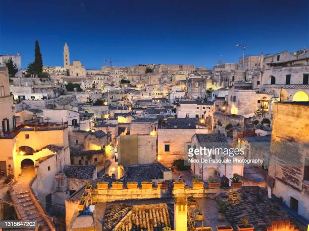 cityscape of matera at dusk - cliff dwelling stock pictures, royalty-free photos & images