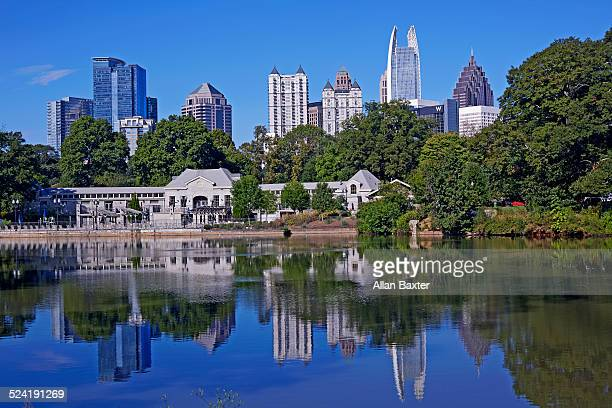 cityscape of midtown atlanta from piedmont park - piedmont park atlanta georgia stock pictures, royalty-free photos & images