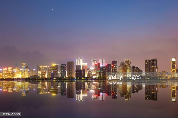 cityscape of modern city near river at dawn - flushing queens stock pictures, royalty-free photos & images