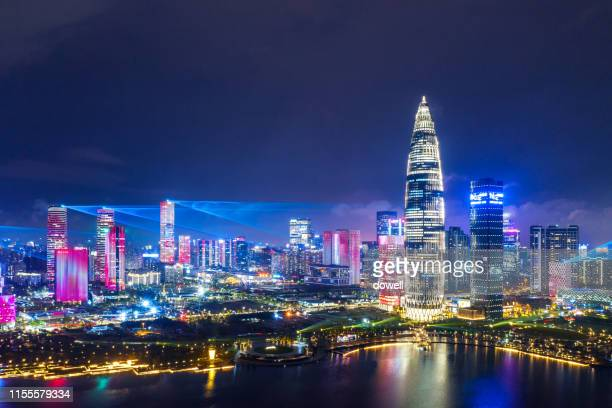 cityscape of modern city shenzhen at night - shenzhen stock pictures, royalty-free photos & images