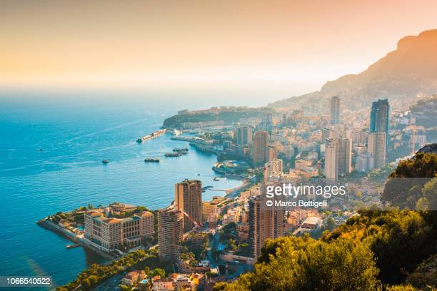 cityscape of monaco and the harbour - monaco stock-fotos und bilder