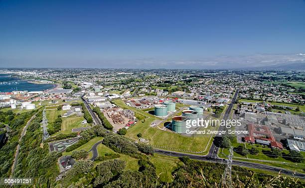 cityscape of new plymouth, industrial park, oil tanks, north island, new zealand - plymouth massachusetts stock photos and pictures
