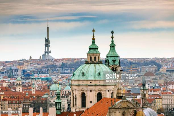 cityscape of prague in winter - st nicholas' church stock pictures, royalty-free photos & images