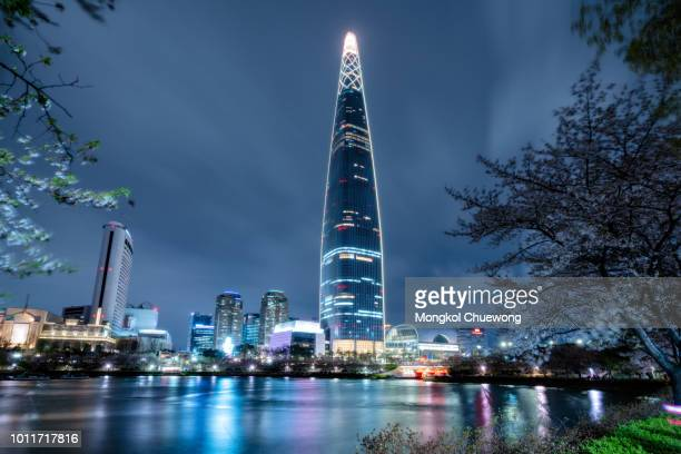 cityscape of seoul downtown city skyline with cherry blossom at night, aerial view of skyscraper at seokchon lake at nightand sakura around lake. the amazing modern building at seoul city, south korea - seoul stock pictures, royalty-free photos & images