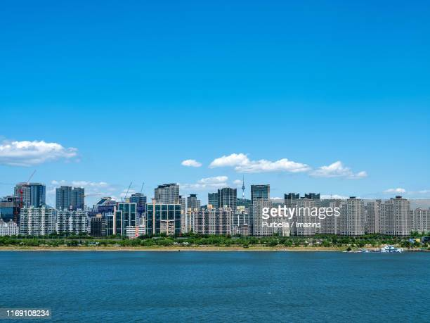 cityscape of seoul with han river, south korea - purbella stock photos and pictures