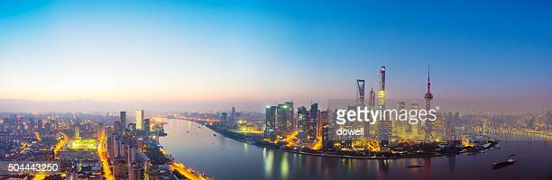cityscape of shanghai and illuminated skyline at dawn