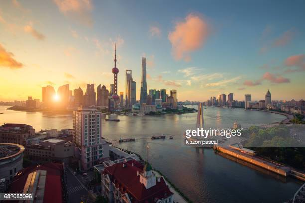 cityscape of shanghai lujiazui district in china during sunrise . . - huangpu river stock photos and pictures