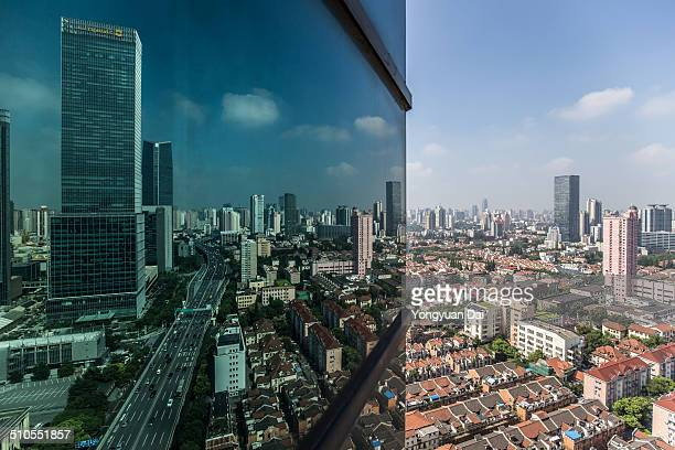 Cityscape of Shanghai reflected by the glass.
