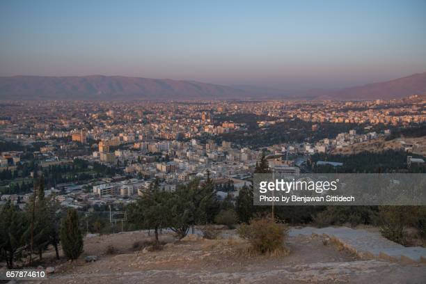 cityscape of shiraz city at sunrise - shiraz stock photos and pictures