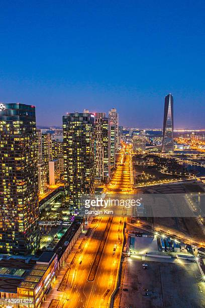 cityscape of skyscrapers at night - songdo ibd stock pictures, royalty-free photos & images