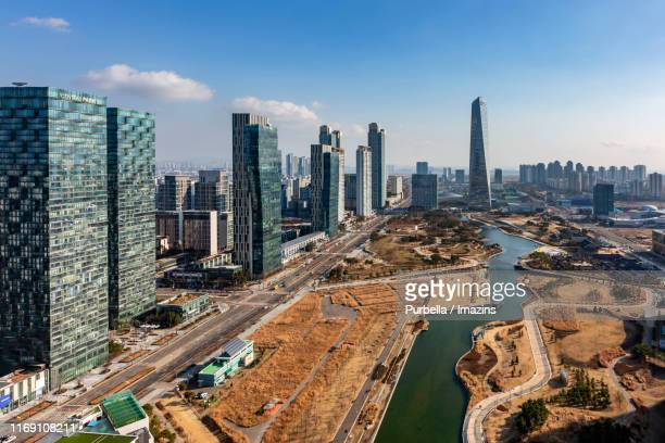 cityscape of songdo central park, songdo, south korea - incheon stock pictures, royalty-free photos & images