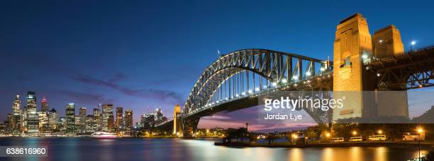cityscape of sydney at twilight - sydney harbour bridge stock pictures, royalty-free photos & images