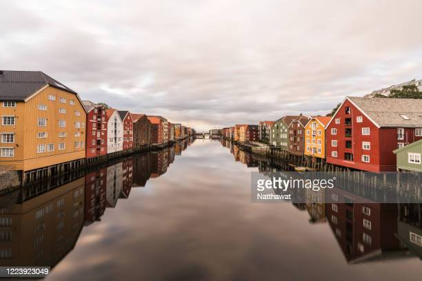 cityscape of trondheim old town at sunset, norway - トロンハイム ストックフォトと画像