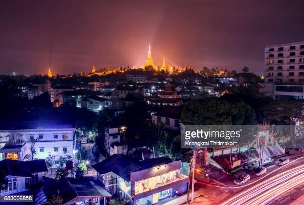 Cityscape of Yangon city with Shwedagon Pagoda by night, Myanmar.