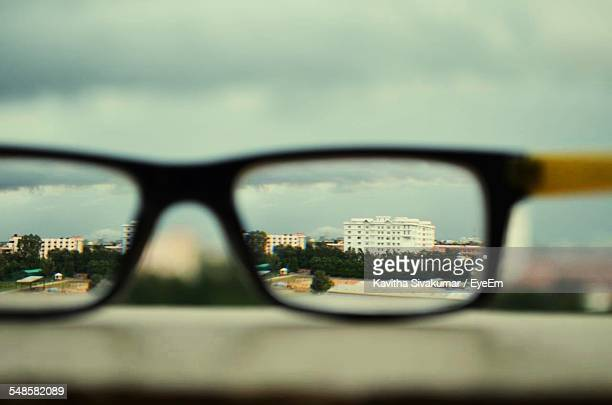 Cityscape Reflecting In Glasses