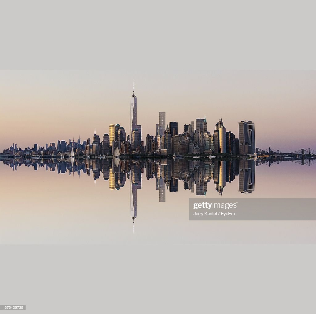 Cityscape Reflecting In River At Dusk : Stock Photo