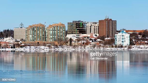 cityscape reflection in wet ice - barrie stock pictures, royalty-free photos & images
