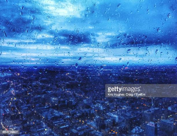 cityscape seen through window glass of cn tower during rainy season - torrential rain stock pictures, royalty-free photos & images