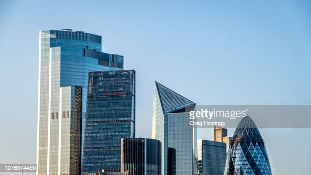 cityscape skyline view of modern futuristic skyscrapers in the city of london, england, uk - central bank stock pictures, royalty-free photos & images
