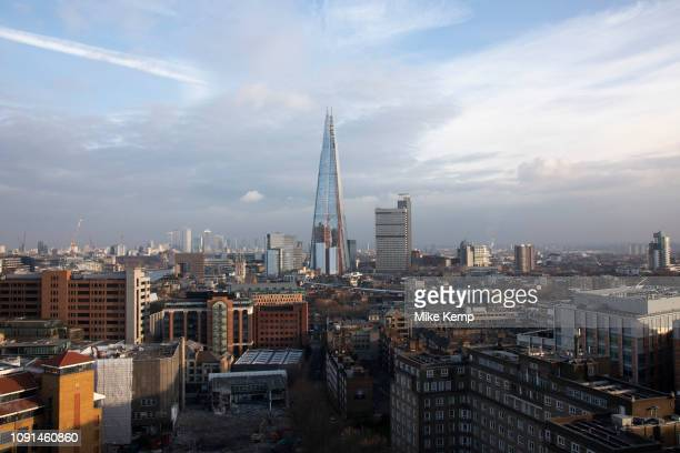 Cityscape skyline view over rooftops in Southwark and London Bridge towards The Shard and in the distance the financial district and skyscrapers at...