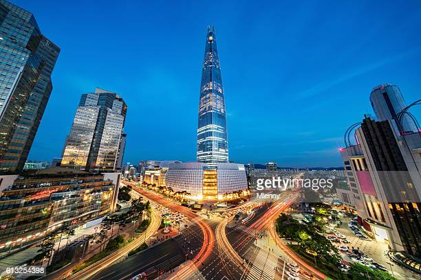 cityscape songpagu skyscrapers lotte world tower at night seoul - tower stock pictures, royalty-free photos & images