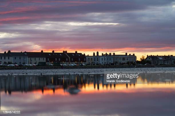 cityscape, sunset behind townhouses, reflection in the water - town stock pictures, royalty-free photos & images