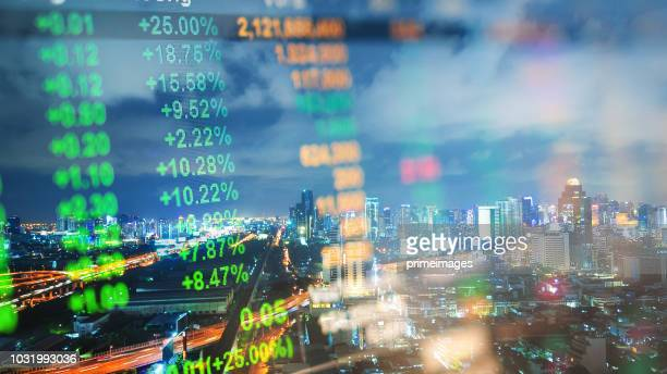 cityscape thailand with investment theme background and stock market chart - economy stock pictures, royalty-free photos & images