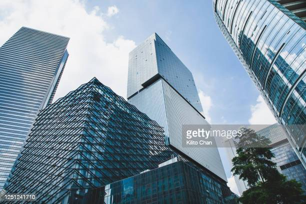 cityscape under clear sky - asymmetry stock pictures, royalty-free photos & images