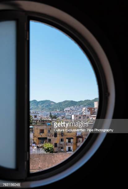 cityscape view from circular window, tirana, albania - tirana stock pictures, royalty-free photos & images