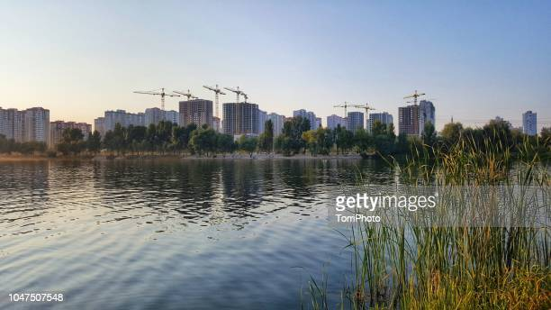 cityscape view from the lake - kiev stock pictures, royalty-free photos & images