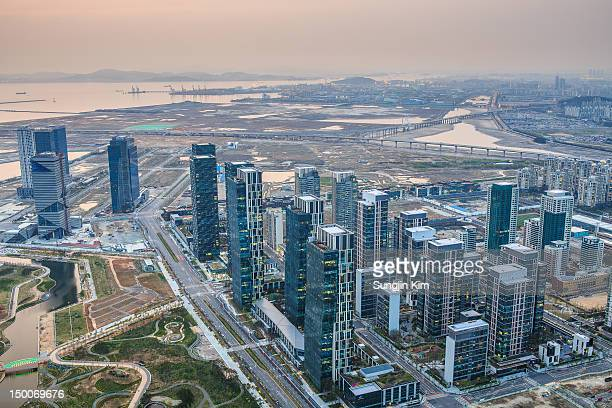 cityscape viewed from rooftop - songdo ibd stock pictures, royalty-free photos & images