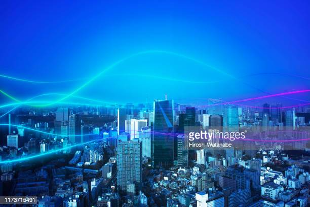 cityscape with abstract light trail - big data city stock pictures, royalty-free photos & images