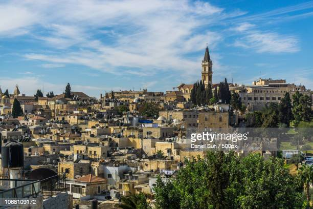 cityscape with bell tower, israel - jericho stock photos and pictures