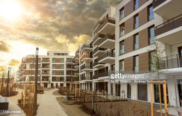 cityscape with facade of a modern residential building - grounds stock pictures, royalty-free photos & images