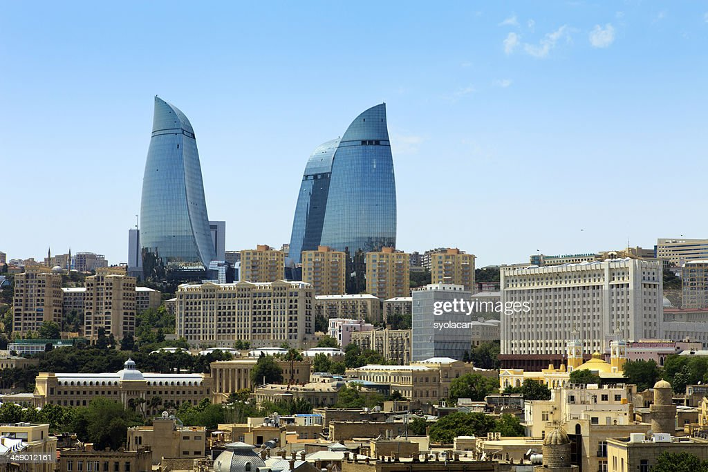 Cityscape with Flame Towers : Stock Photo