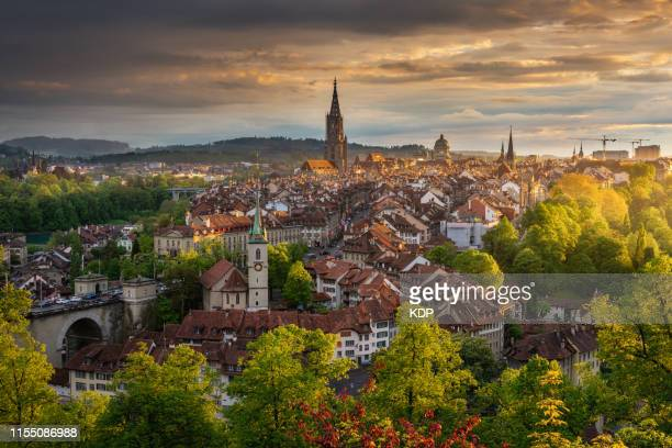 cityscape with golden light sunset in bern, capital of switzerland - bern canton stock pictures, royalty-free photos & images