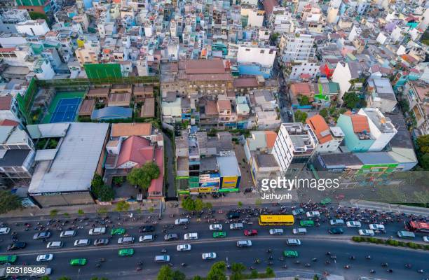 Cityscape with housing and rush hours traffic of Ho Chi Minh city, viewed from top of building