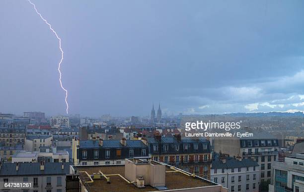 Cityscape With Lightning At Sky