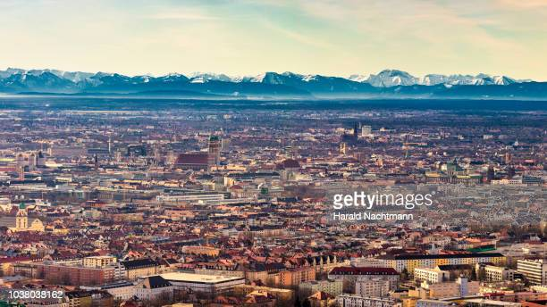 cityscape with mountain range in background, munich, bavaria, germany - münchen stock-fotos und bilder