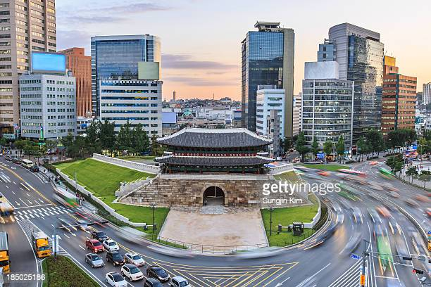 cityscape with old fortress gate - seoul stock-fotos und bilder