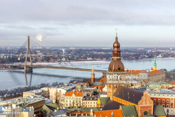 cityscape with old town, river and bridge, riga, latvia - ラトビア ストックフォトと画像