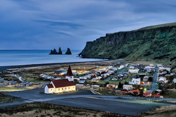 Cityscape with Reynisdrangar rock formations in the background, Vík, Southern Region, Iceland