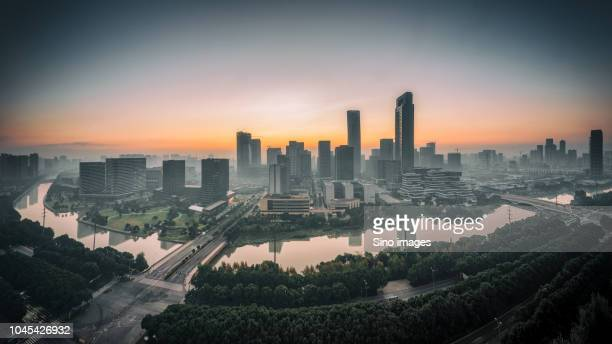 cityscape with skyscrapers and river, at sunset ningbo, zhejiang, china - ningbo stock pictures, royalty-free photos & images