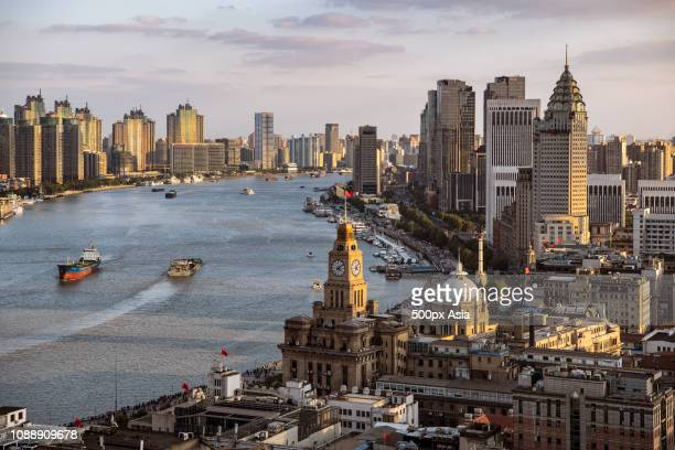 cityscape with skyscrapers and river in shanghai, china - image stockfoto's en -beelden