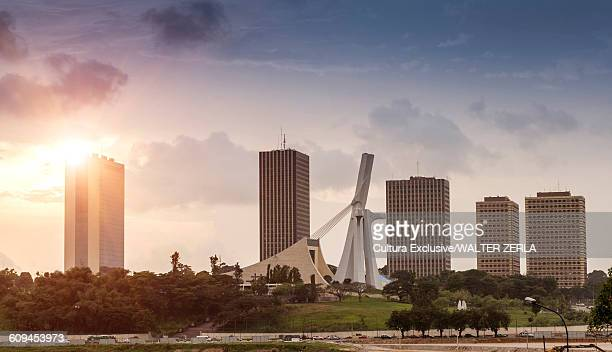 cityscape with skyscrapers and st pauls cathedral, abidjan, ivory coast, africa - abidjan stock pictures, royalty-free photos & images