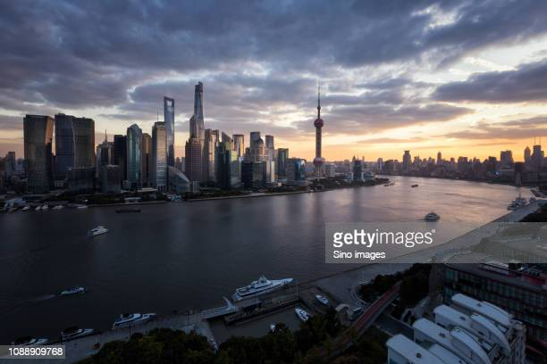 cityscape with skyscrapers at dawn, shanghai, china - image stockfoto's en -beelden