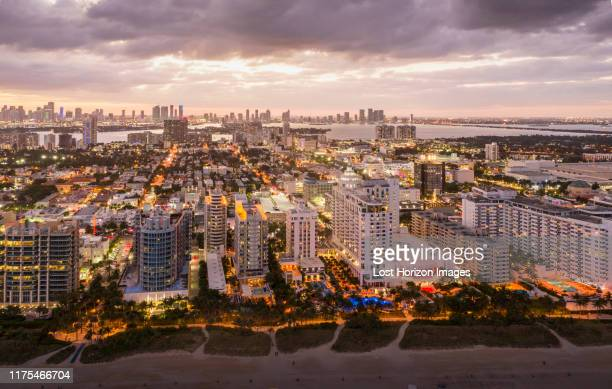 cityscape with skyscrapers at dusk, aerial view, miami beach, florida, united states - miami stock pictures, royalty-free photos & images